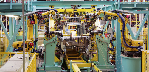 interior of modern automated assembly line for cars in during operation